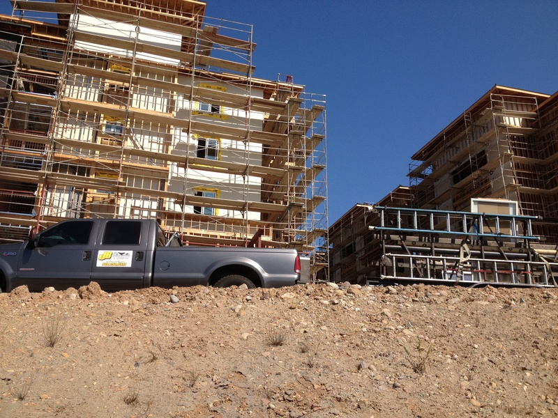 big construction site for new apartments off mira mesa blvd on the I 15, thousands of doors and windows